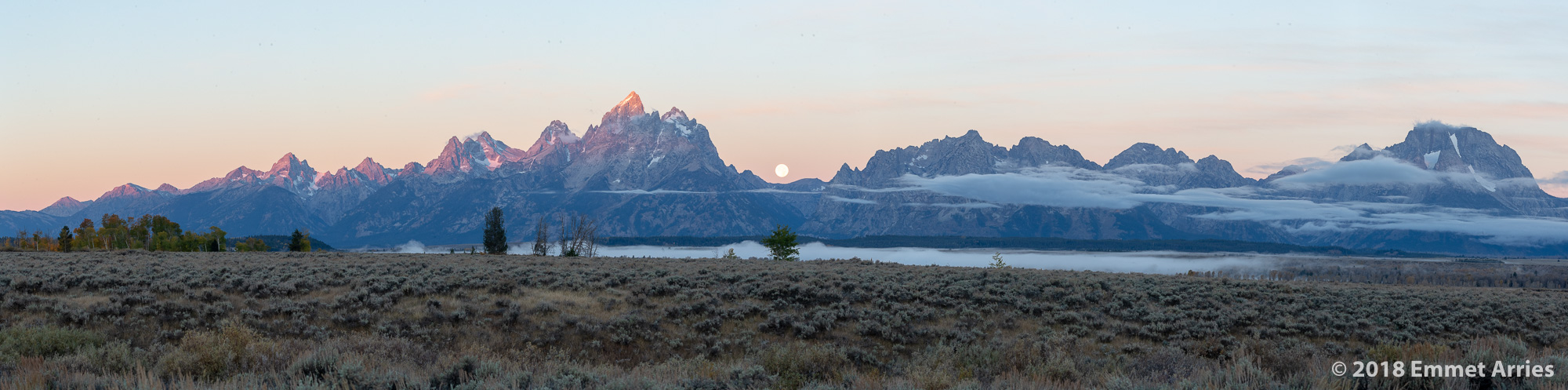 Just as the first light hits the top of the Teton range, casting a glow of pale pink, the full moon nears the horizon. This shot was challenging to capture because I had to research and determine exactly where the moon would set in relationship to Tetons, and I'm very delighted with the result!